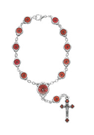 "This auto rosary measures 7 1/4"" long. The beads are a  Job's Tears with a silver ox  Crucifix and Holy Spirit center. Comes with a clasp for easy hanging."