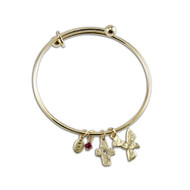 Adjustable gold Bangle with a dangling red crystal, a cross, pray and dove confirmation charms. Gift boxed.
