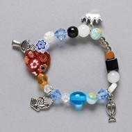 "Communion Story bracelet 6-6.5""L- Stretch. Beads and charms tell the story of the journey to communion."
