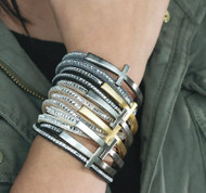 Crystal Cross Wrap is Crafted of Rhodium/18K Gold Plate, Faux Suede and Crystals. Magnetic Closure. Black, Tan or Gray.