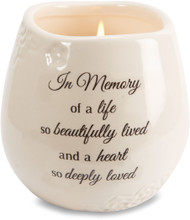 "Ceramic vessel holds 8 ounces of 100% soy wax candle. Tranquility Scent. Measures 2.5L x 2.5W x 3.5H x 2.5D ""In Memory of a live so beautifully lived and a heart so deeply loved"""