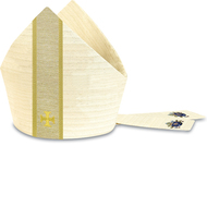 Mitre made of white Cantate, a fabric of 99% wool and 1% gold threads. Comes with natural tone band as applique embroidered with Cross design. Shown and sold here in white. Please indicate the head circumference or hat size in the Comments section at check out. Helpful Hint: measure around the head at middle of the forehead. Lined. Search 5177. NOTE: Shown here with custom embroidery on the lappets that is NOT included. The lappets are plain cantate fabric. Please inquire for custom embroidery. Also available in green, purple, and red and matching ecclesiastical garments are available.