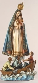 """13"""" Figure of Caridad Del Cobre (Virgin of Charity). Patroness of Cuba. Resin/Stone Mix. 13""""Hx 6.5""""W x 4.5""""D. The story behind the La Virgen de la Caridad del Cobre, began around 1608 (sometime between 1604 and 1612 depending on the source). Two brothers, Rodrigo and Juan de Hoyos, and their slave, Juan Moreno, set out to the Bay of Nipe for salt. They are traditionally called the """"three Juans"""". They needed the salt for the preservation the meat at the Barajagua slaughter house, which supplied the workers and inhabitants of Santiago del Prado, now known as El Cobre. While out in the bay, a storm arose, rocking their tiny boat violently with ongoing waves. Juan, the slave, was wearing a medal with the image of the Virgin Mary. The three men began to pray for her protection. Suddenly, the skies cleared, and the storm was gone. In the distance, they saw a strange object floating in the water. They rowed towards it as the waves brought it towards them. At first they mistook it for a bird, but quickly saw that it was what seemed to be a statue of a girl. At last they were able to determine that it was a statue of the Virgin Mary holding the child Jesus on her right arm and holding a gold cross in her left hand. The statue was fastened to a board with an inscription saying """"Yo Soy la Virgen de la Caridad"""" or """"I am the Virgin of Charity."""" The statue was dressed with real cloth and the Virgin had real hair and skin of a mixed woman. Much to their surprise, the statue remained completely dry while afloat in the water."""