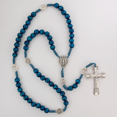 Blue wood beads with silver ox crucifix and center. Silver oxidised Miraculous Medal and Our Father Beads. Plastic gift box. Made in Italy.