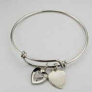 "Adult Faith Bangle. This pewter 2 3/4"" diameter Faith Bangle holds a Holy Spirit and a Heart charm. The heart charm can be engraved with 3 initials only for an additional cost."