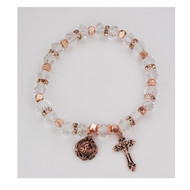 Copper/Crystal Rosary Bracelet. The copper and crystal rosary bracelet consists of copper plated beads, real crystal beads with crystal stone spacer beads, and a real crystal capped Our Father bead. A copper plated crucifix and miraculous medal are attached to the bracelet. Comes carded.