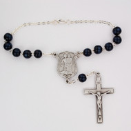 St. Micharl Auto Rosary. 8MM Blue wood beads with pewter police officer badge St Michael center and pewter crucifix. Comes on a hang tag.