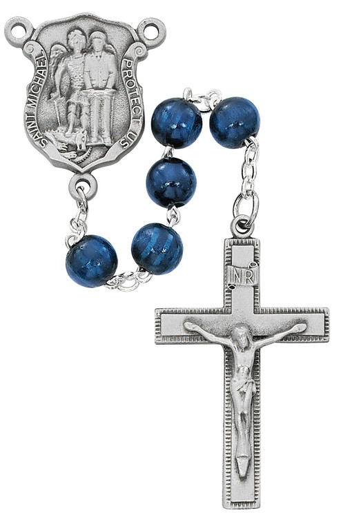 St. Michael Police Blue Wood Rosary. 8MM blue wood beads make up this St. Michael's Police Badge Rosary. St Michael's police badge centerpiece and crucifix are pewter. Comes in a deluxe gift box.