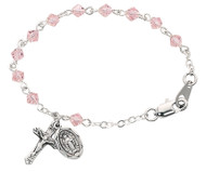 "5 1/2"" Baby Bracelet has 4mm tincut crystal beads with a rhodium plated or sterling silver crucifix and a miraculous medal. Comes in a deluxe gift box."