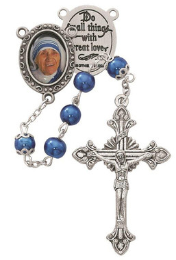 Rosary is made of 7mm blue pearl beads with a pewter decal St. Mother Teresa center and a silver oxidized crucifix. Rosary comes in a deluxe gift box.