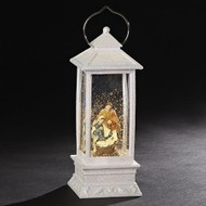 "Swirl effect white 11"" Holy Family Lantern. Holy Family Lantern is battery operated. Batteries are not included. Perfect for a mantle or on a front step!"