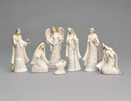 """7 Piece Papercut Nativity set. This 7 Piece Papercut style Nativity is made of a resin/dolomite mix. Set includes the Holy Family and the Three Wise Men. Dimensions are: 7.48""""H x 1.78""""W x 4.13""""L"""