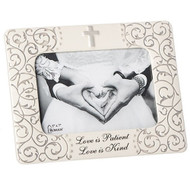 "7.75""H Mr. & Mrs. Scroll Frame.  A simple cross adorns the top of the frame, while the bottom of the frame has the wording ""Love is Patient, Love is Kind"" Scrolling adorns both sides of the frame. Perfect Wedding or Anniversary gift. Holds a 5' x 7"" photo."