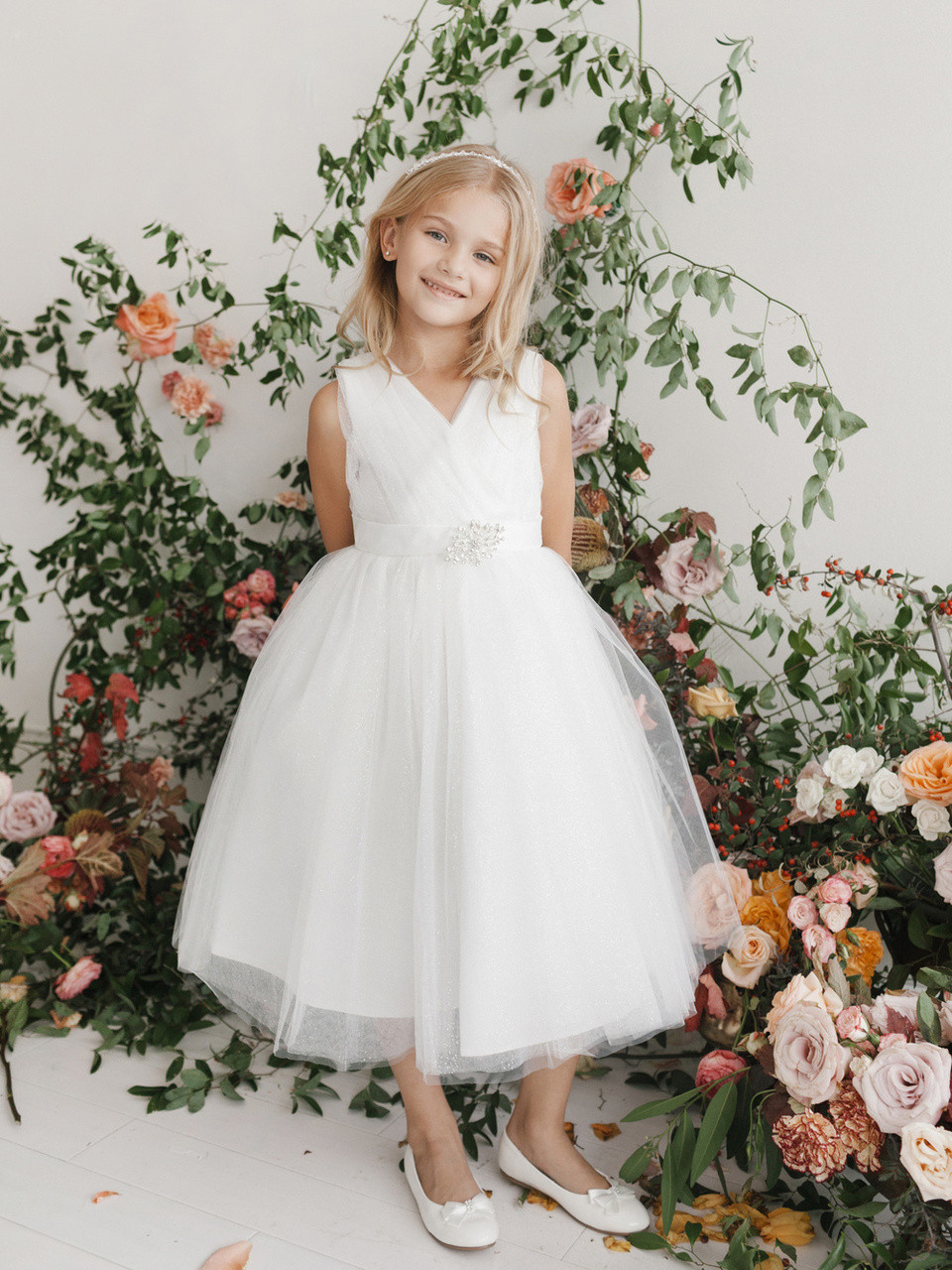f5e27428 This Communion dress has a V Neckline and a glitter tulle skirt. The dress  also