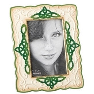 "8.5"" Irish Frame. Celtic Knots surround this frame that holds a 4"" x 6"" picture. Frame is made of a resin/stone mix"