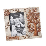 "7.25"" Tree of Life Family Frame. Tree of Life Family frame that holds a 4"" x 6"" picture. Frame is in copper and ivory tones. The Tree of Life frame is  made of a resin/stone mix"