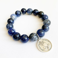 "Dark Blue Sodalite with the Serenity Prayer Charm Semi-precious gemstones and charm & logo disc charm.  12mm beads.  Size: approximately 7.25"". Each natural gemstone is unique and therefore no two are alike. Stones, colors, and sizes may vary. Handmade"