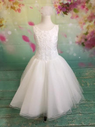 Give your little girl the highest quality dress for her special day! Our dresses are made with the finest materials. Our dresses are decorated with the highest-quality embellishments. Custom made First Communion dresses. Long, short, and sleeveless communion dresses. With our collection of Christine Helene's Signature/Angel custom communion dresses, you are assured that your child's first communion is truly a special occasion. This dress is guaranteed to make your special girl shine. It has short sleeves, and is made with the highest quality fabric and crystal embellishments at the waist of the dress. What's included: White Organza White French Net White Bridal Satin Embroidery Pearls Sequins Crystals We pride ourselves in helping make your child's first communion the best it can be. Please call us at 1.800.523.7604 for verification of items in stock as they are selling quickly! No returns or exchanges!
