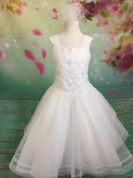Give your little girl the highest quality dress for her special day! Our dresses are made with the finest materials. Our dresses are decorated with the highest-quality embellishments. Custom made First Communion dresses. Long, short, and sleeveless communion dresses. With our collection of Christine Helene's Signature/Angel custom communion dresses, you are assured that your child's first communion is truly a special occasion. This dress is guaranteed to make your special girl shine. It has short sleeves, and is made with the highest quality fabric and crystal embellishments at the waist of the dress. What's included: White Organza White French Net White Bridal Satin Embroidery Pearls Sequins Crystals Sized Girls 2-12NL We pride ourselves in helping make your child's first communion the best it can be. Please call us at 1.800.523.7604 for verification of items in stock as they are selling quickly! No returns or exchanges!