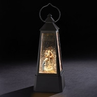 """11"""" Lantern with the Holy Family. Battery operated. Swirl confetti. Made of plastic. Dimensions are: 10.75""""H x 4.125""""W x 4.125""""D. Batteries not included."""