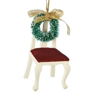 "Memorial Chair Ornament. 3.5"" chair has a wreath on the back of chair. 3.5""H Chair with wreath memorial is made of wood and complete measurements are: 3.5""H 1.75""W 1.75""D"