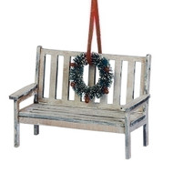 "Bench with Wreath Ornament. 3"" bench has a wreath on the back of chair. 3""H bench with wreath is made of medium density  fiberboard. Complete measurements are: 3""H x 4 ""W x 2""D"