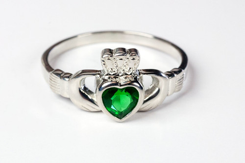 Women's Sterling Silver with Emerald Glass Accents Claddagh Ring. Sizes 4-9. Hand Made in the USA. Lifetime Guarantee against tarnishing and defects.  Also 14K gold ring available. Call for pricing