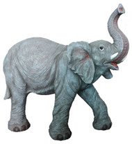 Large elephant Nativity figure with its trunk in the air.