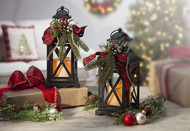 "Set of Two LED Metal Lanterns! This two pack of 10 1/2""H black metal lanterns are decorated and ready to go for the holidays! Battery operated!"