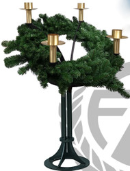 """Designed and handcrafted in Tulsa, Oklahoma, this Advent wreath is available in your choice of black or gold powder coat finish.  A 35-inch diameter ring is held up at the base. There are four 3"""" brass candle sockets finished in a satin bronze. Greenery wreath is included in this style. The candle holders are removable for procession and from the center, another support holds a spiked brass bobeche for a three-inch Christ candle.  Please specify your candle socket size up to 3 inches.  Advent candles to fit this wreath are sold separately. Made in the USA Church Advent Floor Wreath Details: 35"""" Aluminum Wreath 3"""" Candle Sockets (Standard) Greenery Wreath Included Please Select Black or Gold Finish  Made in the USA"""
