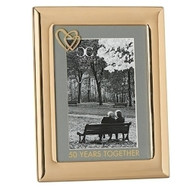 50 Years Together Photo Frame from the Caroline Collection. Frame is made of zinc alloy and is lead free. The 50 Years Together Photo Frame presents with two hearts in the upper left hand corner with 50 Years Together printed on the matting of the frame. Photo frame hold and 4 x 6 photo.