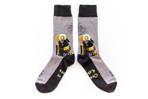 "The innovator of religious orders as we know them today, St. Benedict is beloved by many! This simple design mimics the simple, humble life he lived. A raven on his shoulder and a chalice with a snake by his side, will remind you of the miraculous power of God, working to save this faithful soul from enemies attempts to poison him. These socks will be the perfect reminder to live the Benedictine motto, ""Ora et Labora,"" meaning pray and work, keeping all tasks in your day prayerful."