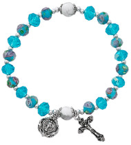 """7 1/2"""" Adult Aqua Flower Crystal Stretch Bracelets.  Aqua Lower beads with aqua crystal bead stretch bracelet Miraculous medal and crucifix are oxidised silver. Bracelet comes carded.  Made in the USA!"""