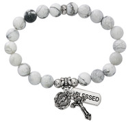 """7 1/2"""" Adult Howlite Beads Stretch Bracelet.  Miraculous medal and crucifix are oxidised silver. Bracelet comes carded.  Made in the USA!"""