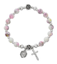 "Youth 6mm pink and yellow marbeline beads with silver oxidised medal and crucifix. 61/2"" round. Made in Italy"