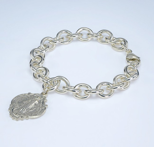 """Extra heavy solid sterling silver link style bracelet with hail Mary Miraculous Charm. 7 1/2"""" Bracelet comes in a deluxe velvet gift box. Made in the USA"""