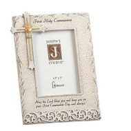 "8"" Stone Finish Holy Communion Frame adorned with a cross in the upper left hand corner and First Holy Communion written across top of frame. A blessing is also written at the bottom of frame.  Frame measures 8""H  and holds a 3.5"" x 5"" picture."