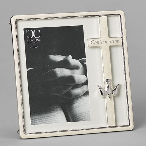 """Confirmation Frame from the Caroline Collection.  This 7.25""""H white and silver frame holds a 4"""" x 6"""" photo. There is a white cross with a silver dove that adorns the one side of the frame. The Confimation Frame is made of a zinc alloy-lead free."""