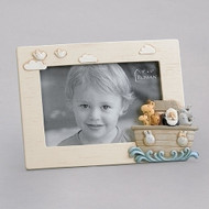 "5.75""H ""Noah's Ark"" photo frame.  The photo frame has a conglomerate of animals in the ark on the on bottom right side of the Photo Frame. Frame is made of a resin stone mix. The 5.75"" photo frame holds a 4"" x 6"" photo."