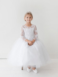 This communion dress has a lovely illusion neckline and long sleeves with lace appliques. The skirt of the dress is tulle.