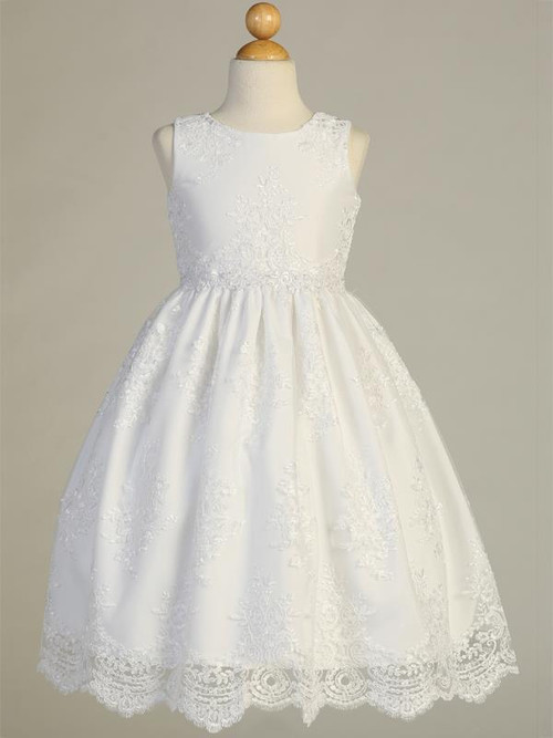 Corded embroidery lace on tulle Communion Dress. Dress is tea length. Made in the USA