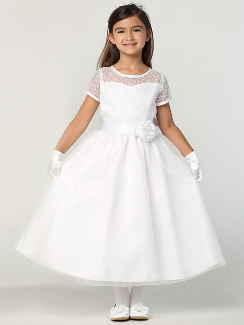 Lovely Embroidered Tulle Communion Dress. Dress has an embroidered tulle bodice with an organza skirt. Dress has an illusion neckline and short sleeves. Satin sash with flower at the waist. Dress is tea length. Made in the USA