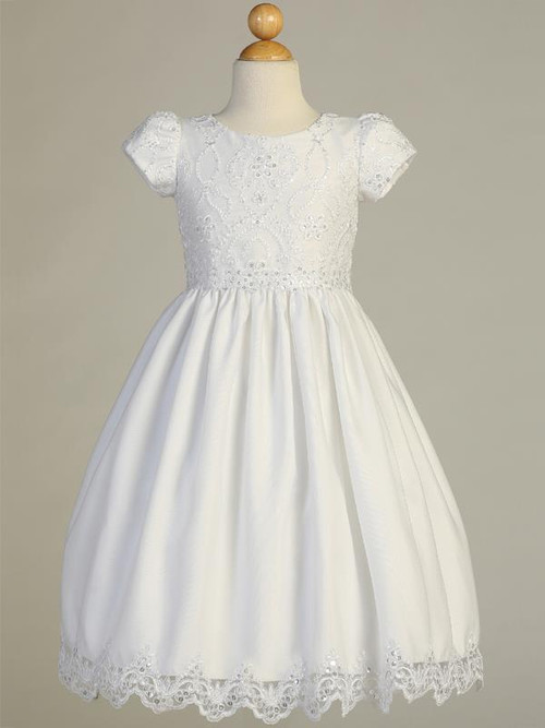 Lovely Embroidered LaceTulle Communion Dress. Dress has corded and embroidered  trim on the tulle skiirt.  bodice with an organza skirt. Dress is tea length. Made in the USA