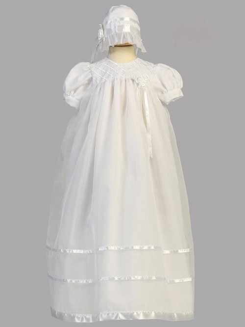 Embroidered yoke and satin ribbons adorn this long organza christening gown. Bonnet included Made in the USA.