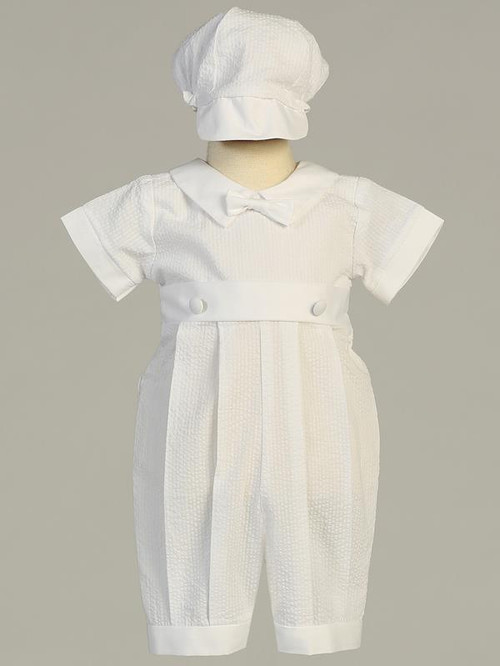 Poly seersucker cotton romper with pleats. Hat is included. Sizes: 0-3mos, 3-6mos, 6-12mos, 12- 18mos. Made in the USA