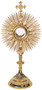 Image of a 24K gold-plated monstrance with silver filigree. The base features four oxidized medallions to represent the four evangelists. The lunula is available with either a clip style or enclosed glass.