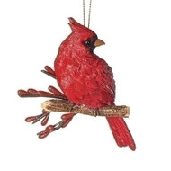 "4.5"" Christmas Cardinal on a Branch Ornament. Made of a resin/stone mix, the Cardinal on a Branch Ornament measurements are: 4.25""H x 3.5""W x 1.75""D."