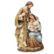 "Jewel Tone Holy Family Statuette. This statuette of Joseph, Mary and baby Jesus is composed of beautiful jewel tone colors. The jewel tone and ornately patterned statuette of Jesus,  Mary,  and Joseph measures 9.5""H x 5.5""W x 4.5"" and is made of a polyresin."