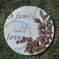 "A Family of Love Round Stepping Stone.  This Family of Love Round Stepping Stone is 9""H. The stepping stone is adorned with flowers and the words ""A family is a circle of love"" is written in several places on the stepping stone."