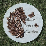 """Bless This Garden"" Stepping Stone.  This ""Bless This Garden"" Round Stepping Stone is 9""H. The stepping stone is adorned with flowers and the words ""Bless this Garden"" is written on the  stepping stone. Stepping Stone is adorned with leaves adn a butterfly."
